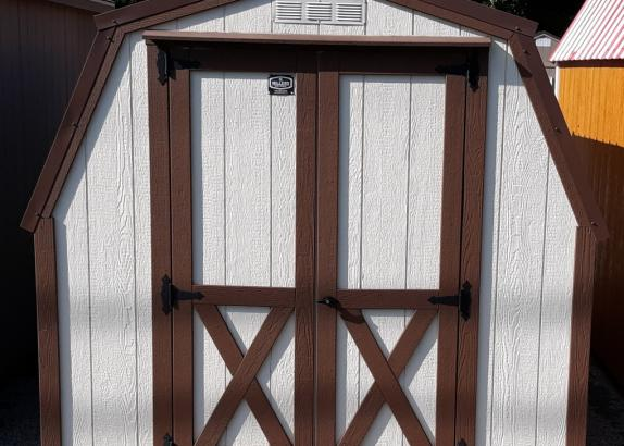 Model 7193 8x12 Navajo White with Chestnut trim, 4' wall shed